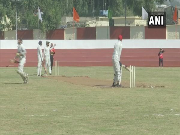 Players playing cricket at the newly-constructed sports stadium in Rajouri