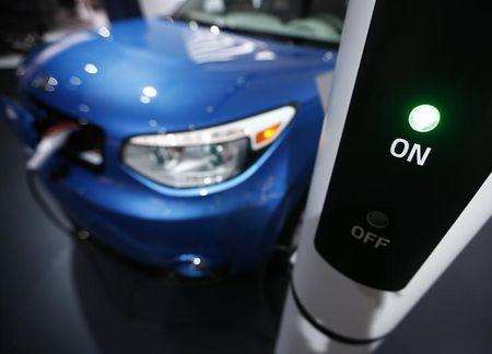 A Kia Soul EV is plugged into a charging station during the second press day of the North American International Auto Show in Detroit, Michigan, January 13, 2015. REUTERS/Mark Blinch/Files