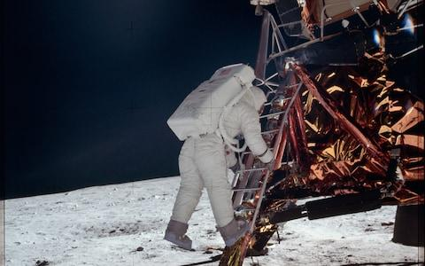 Aldrin prepares to take his first step on the moon - Credit: NASA