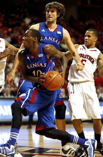 Kansas' Tyshawn Taylor drives to the basket during AN NCAA college basketball game agaisnt Texas Tech in Lubbock, Texas, Wednesday, Jan.11, 2012. (AP Photo/Lubbock Avalanche-Journal, Stephen Spillman)
