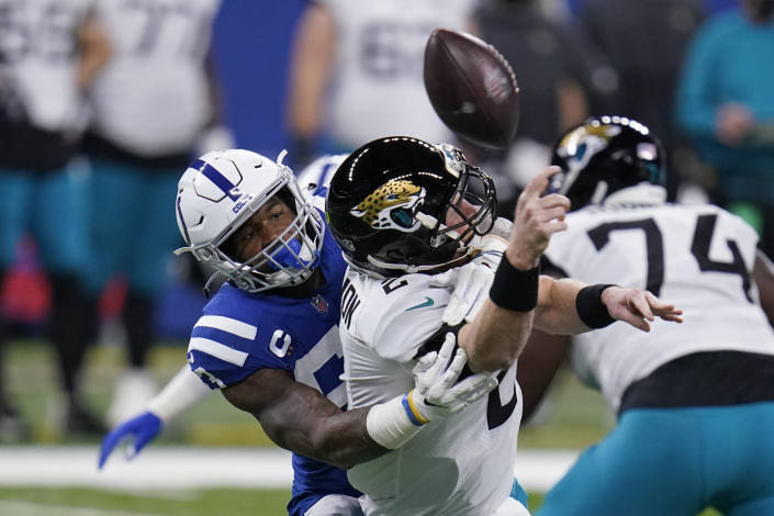 Jacksonville Jaguars quarterback Mike Glennon (2) fumbles the ball as hit by by Indianapolis Colts' Darius Leonard (53) during the first half of an NFL football game, Sunday, Jan. 3, 2021, in Indianapolis. (AP Photo/Michael Conroy)