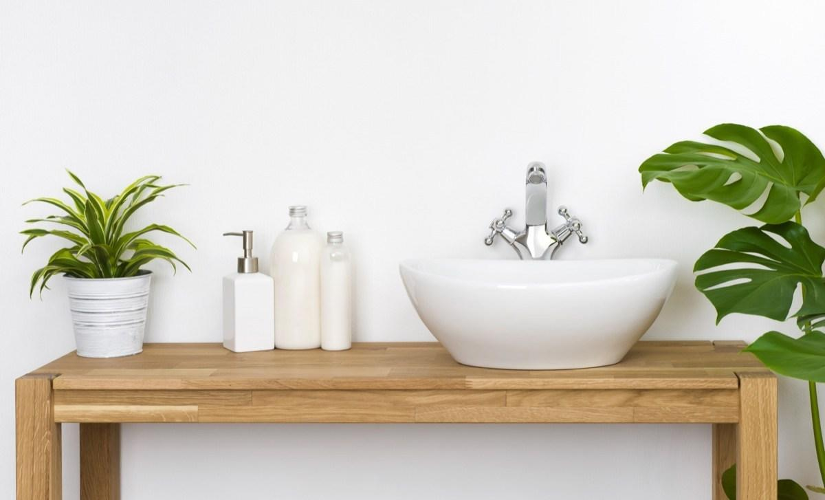 """White walls have become increasingly more popular in bathrooms, making things look new and sparkling. But that brand new look only lasts for so long, says Aaron. She points out that """"stains are very visible on white walls,"""" and when the bathroom is typically """"<a href=""""https://bestlifeonline.com/bathroom-health-risks/?utm_source=yahoo-news&utm_medium=feed&utm_campaign=yahoo-feed"""" target=""""_blank"""">one of the grossest rooms in the house</a>,"""" it's just not the smartest choice.  """"This is the one room that we would recommend going bold—maybe painting the walls a coral pink or orange,"""" says <strong>Ashley Baskin</strong>, real estate agent and board member of <a href=""""https://homelifedigest.com/"""" target=""""_blank"""">Home Life Digest</a>. """"This type of statement can lighten up the home and allow you to show your true colors."""""""