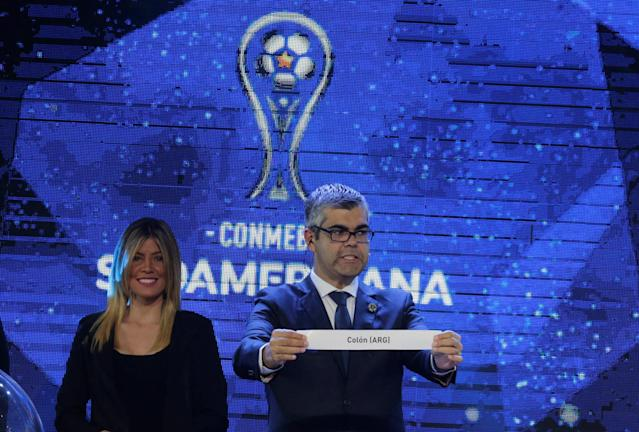 Soccer Football - 2018 Copa Libertadores and Copa Sudamericana Draw - CONMEBOL headquarters, Luque, Paraguay - June 4, 2018 Director of Club Competitions Frederico Nantes holds up a piece of paper showing out Argentina's Colon, during the draw. REUTERS/Jorge Adorno