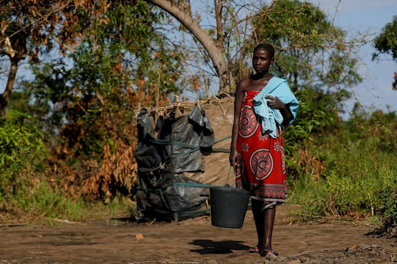 "Maria Jofresse, 25, stands after having a shower near her collapsed house outside the village of Cheia, which means ""Flood"" in Portuguese, near Beira, Mozambique April 2, 2019. (Photo: Zohra Bensemra/Reuters)"