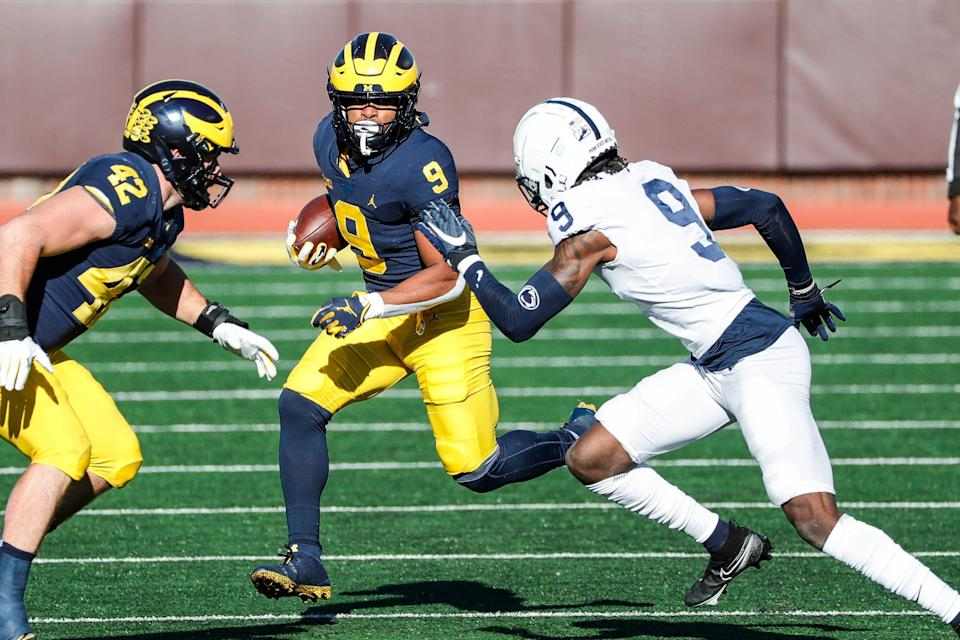 Michigan running back Chris Evans runs against Penn State cornerback Joey Porter Jr. during the first half at Michigan Stadium in Ann Arbor, Saturday, Nov. 28, 2020.