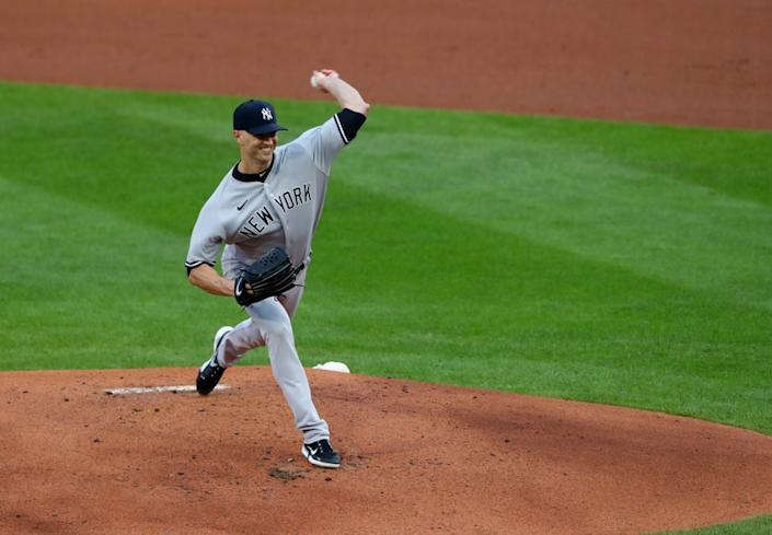 J.A. Happ throws pitches against Blue Jays