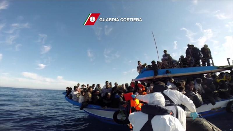 In this video grab released by the Italian Coast Guards (Guardia Costiera) on April 13, 2015 a boat of the Italian Guardia Costiera takes part in a rescue operation of migrants off the coast of Sicily on April 12, 2015 (AFP Photo/)