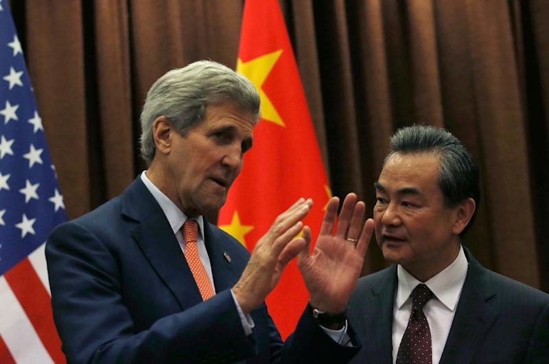 US Secretary of State John Kerry (L) speaks with Chinese Foreign Minister Wang Yi prior to their meeting at the Ministry of Foreign Affairs in Beijing on May 16, 2015 (AFP Photo/Kim Kyung-Hoon)