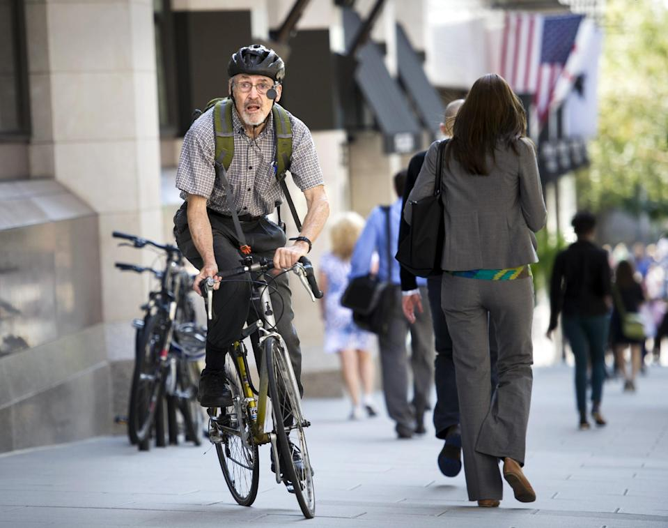 "Retired physician David Hilfiker, of Washington, leaves the National Press Club on his bike after talking about his life with Aalzheimer's in Washington, Thursday, Sept. 19, 2013. Hilfiker, was diagnosed in September 2012, and has been writing about the experience of losing his mental capacity in his blog ""Watching the Lights Go Out."" Nearly half of all seniors who need some form of long-term care, from help at home to full-time care in a facility, have dementia, the World Alzheimer Report said Thursday. (AP Photo/Cliff Owen)"