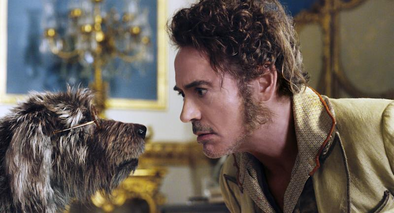 DOLITTLE, from left: dog Jip (voice: Tom Holland), Robert Downey Jr. as Dr. John Dolittle, 2020. Universal Pictures / courtesy Everett Collection