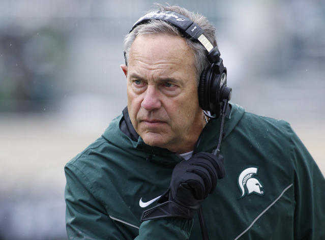 FILE - In this Oct. 27, 2018, file photo, Michigan State coach Mark Dantonio watches the second quarter of the team's NCAA college football game against Purdue in East Lansing, Mich. Brad Salem is taking over as Michigan State's offensive coordinator after Dantonio rearranged several roles on his staff. The Spartans did not announce any firings or new hires Thursday, Jan. 10, but several assistants will be in different jobs. Salem moves from quarterbacks coach to offensive coordinator, and he'll also coach running backs. Dave Warner and Jim Bollman, who have been co-offensive coordinators for Michigan State, will no longer have that duty. Warner will coach quarterbacks, and Bollman will coach the offensive line. (AP Photo/Al Goldis, File)