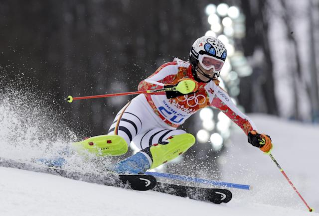 Germany's Maria Hoefl-Riesch skis to the gold medal in the women's supercombined in the Sochi 2014 Winter Olympics, Monday, Feb. 10, 2014, in Krasnaya Polyana, Russia. (AP Photo/Luca Bruno)