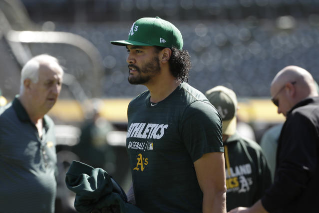 Oakland Athletics pitcher Sean Manaea walks on the field during baseball practice in Oakland, Calif., Tuesday, Oct. 1, 2019. The Athletics are scheduled to face the Tampa Bay Rays in an American League wild-card game Wednesday, Oct. 2. (AP Photo/Jeff Chiu)
