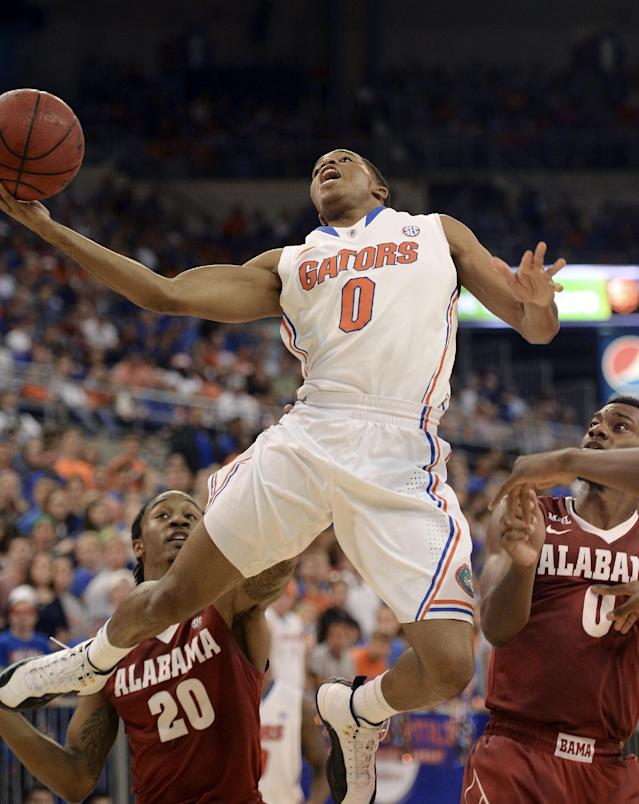 Florida's Kasey Hill goes up for two points as Alabama guard Levi Randolph (20) and Algie Key (0) look on during the first half of an NCAA college basketball game Saturday, Feb. 8, 2014, in Gainesville, Fla.(AP Photo/Phil Sandlin)