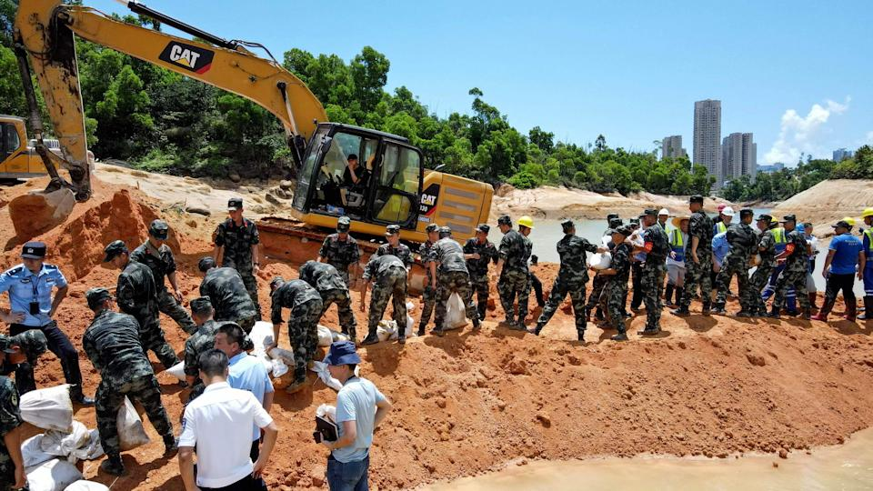 Paramilitary police officers work on trying to rescue 14 workers trapped in Zhuhai, in China's southern Guangdong province (AFP via Getty Images)