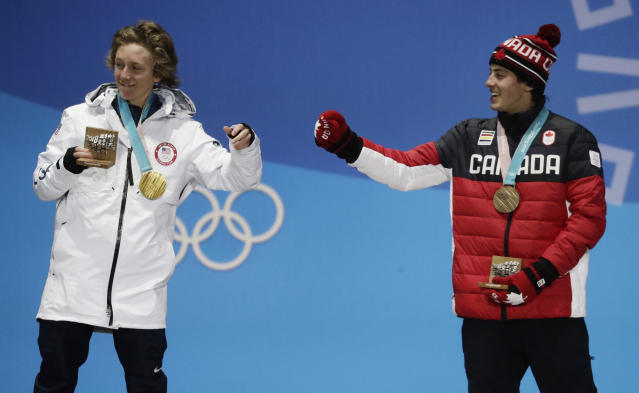Men's slopestyle gold medalist Red Gerard, of the United States, left, and bronze medalist Mark McMorris, of Canada, celebrate during the medals ceremony. (AP Photo)