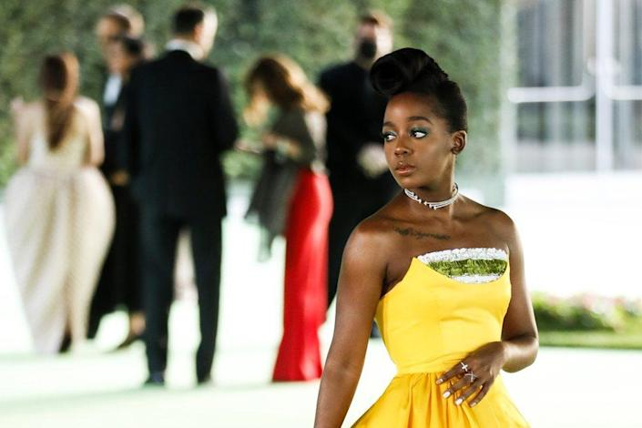 South African actress Thuso Mbedu poses on the the red carpet on arrival for the opening gala of the Academy Museum of Motion Pictures in Los Angeles, California, USA, 25 September 2021. The museum is set to open to the public on 30 September 2021.
