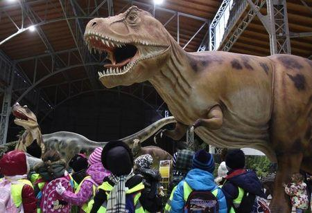 Children watch life-sized Tyrannosaurus Rex dinosaur model in Vienna