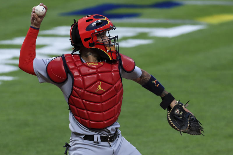 St. Louis Cardinals' Yadier Molina throws to second base during a baseball game against the Cincinnati Reds in Cincinnati, Monday, Aug. 31, 2020. The Cardinals won 7-5. (AP Photo/Aaron Doster)