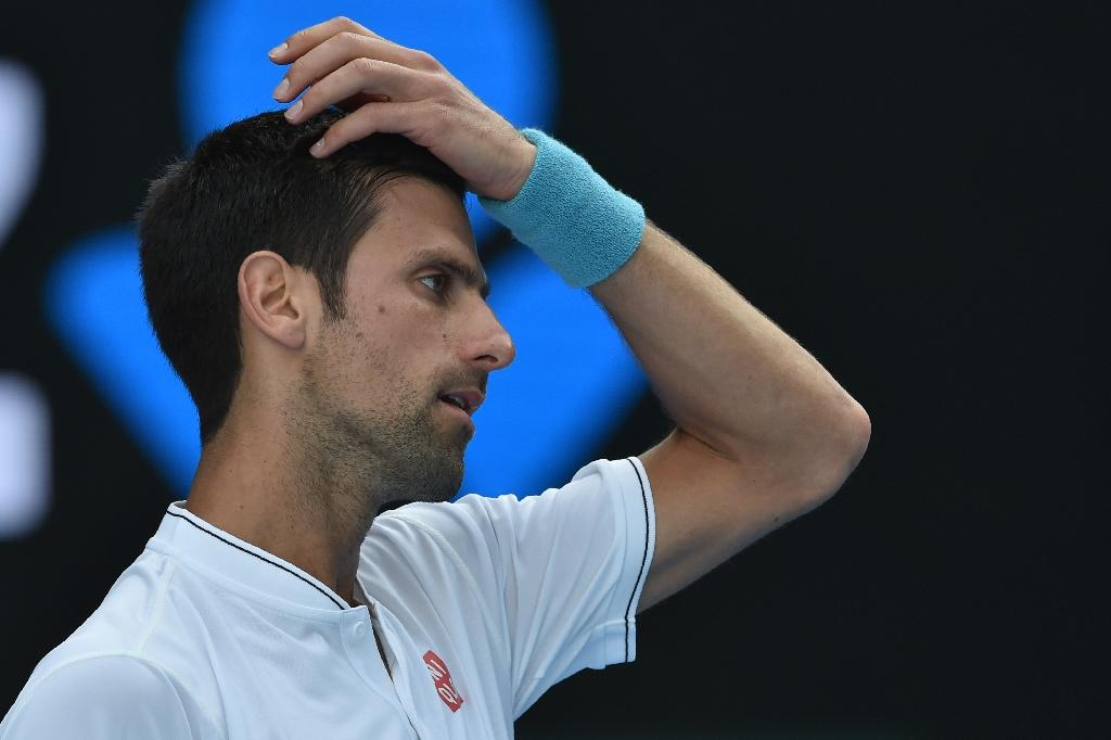 Novak Djokovic crashed out to unheralded Denis Istomin in five sets on Thursday in the world number two's earliest exit from a major since Wimbledon 2008 (AFP Photo/PAUL CROCK                     )
