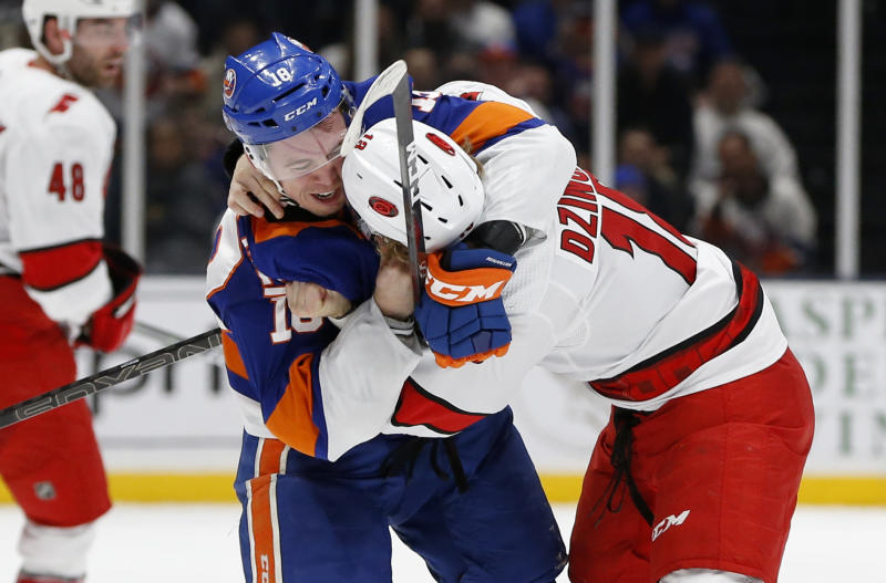 New York Islanders left wing Anthony Beauvillier (18) and Carolina Hurricanes center Ryan Dzingel (18) fight during the second period of an NHL hockey game, Saturday, March 7, 2020, in Uniondale, NY. (AP Photo/Jim McIsaac)