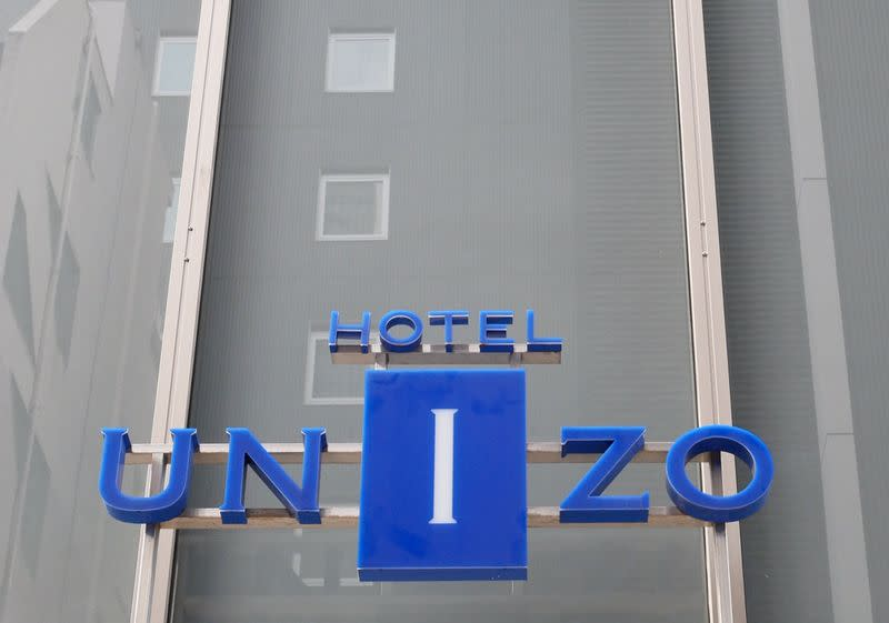 The logo of Hotel Unizo, operated by Japanese hotel operator Unizo Holdings, is seen at the entrance of the hotel in Tokyo, Japan