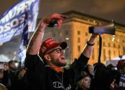 Supporters of U.S. President Donald Trump gather at a rally at Freedom Plaza in Washington