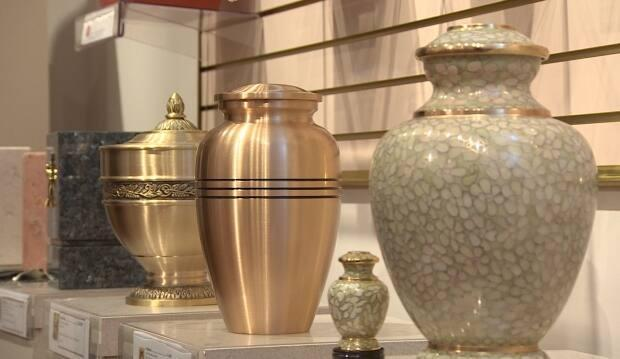 A display of urns for holding cremated remains.  According to a 2019 B.C. Vital Statistics report, cremations are much more common than burials in Smithers, B.C., but the community doesn't allow cremations within town limits.  (Sherry Vivian/CBC - image credit)