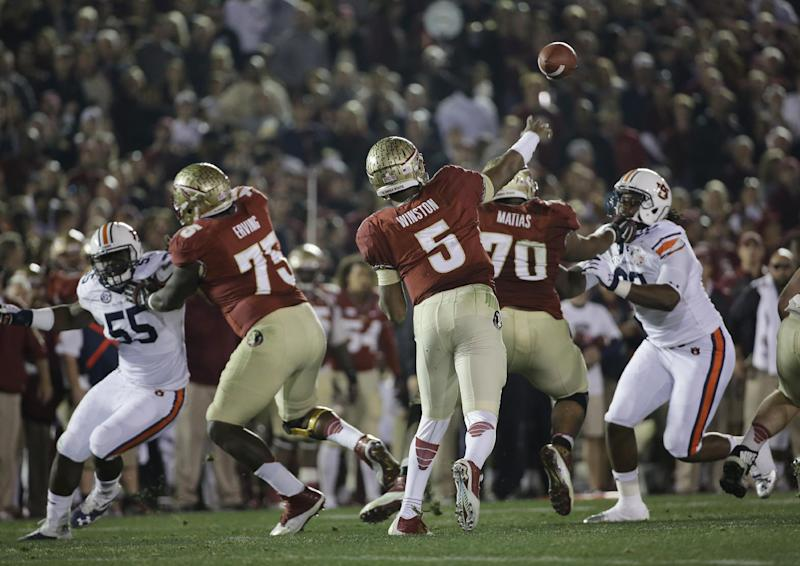 Florida State's Jameis Winston throws during the first half of the NCAA BCS National Championship college football game against Auburn Monday, Jan. 6, 2014, in Pasadena, Calif. (AP Photo/David J. Phillip)