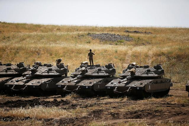 <p>Israeli soldiers stand on tanks in the Israeli-occupied Golan Heights, Israel, May 10, 2018. (Photo: Ronen Zvulun/Reuters) </p>