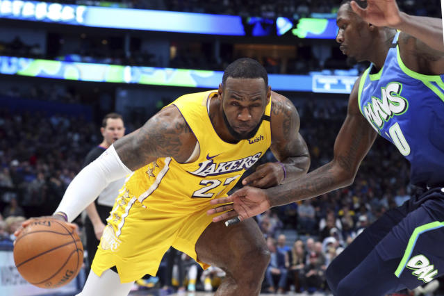 Los Angeles Lakers forward LeBron James (23) tries to drive past Dallas Mavericks forward Dorian Finney-Smith (10) during the second half of an NBA basketball game Friday, Jan. 10, 2020, in Dallas. (AP Photo/Richard W. Rodriguez)