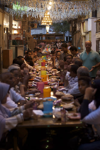 Festivities with friends and family take place within the home, parks, restaurants, and spill out onto side streets.