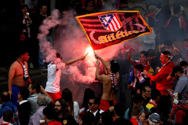 Soccer Football - Atletico Madrid Celebrate Winning The Europa League - Neptuno Square, Madrid, Spain - May 18, 2018 Atletico Madrid fans with a flare REUTERS/Juan Medina