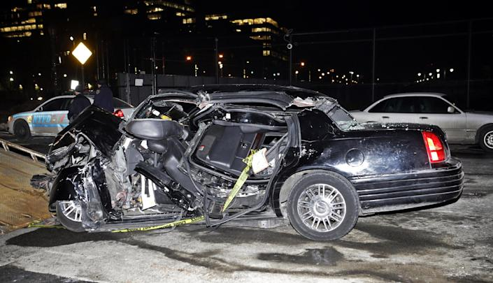 """A car remains on the scene of an accident in New York, Wednesday, Feb. 11, 2015, that killed longtime """"60 Minutes"""" correspondent Bob Simon. Simon covered riots, Academy Award-nominated movies and wars and was held captive for more than a month in Iraq two decades ago. He was 73. (AP Photo/Kathy Willens)"""