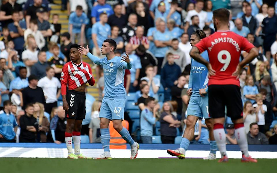 Manchester City's Phil Foden, second left, reacts after Raheem Sterling's, not pictured, goal was disallowed for offside after a VAR replay - AP