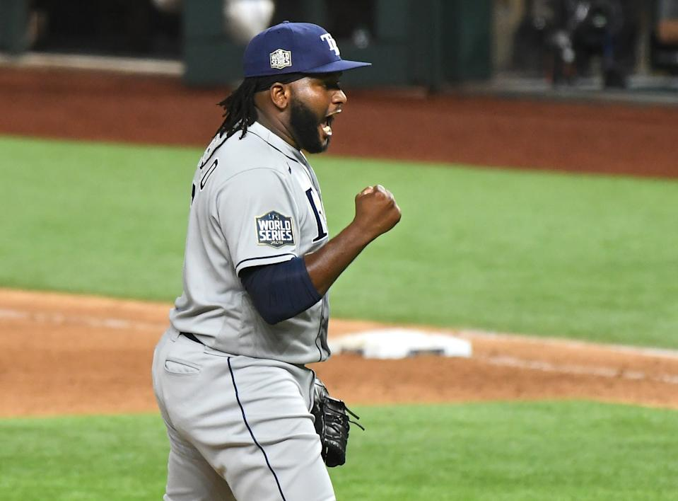 Rays relief pitcher Diego Castillo celebrates after defeating the Dodgers in Game 2 of the World Series.