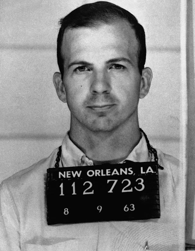 <p>Lee Harvey Oswald in a police photo after being arrested for protesting U.S. policy in Cuba. On Nov. 22, 1963, he was arrested on charges of assassinating President John F. Kennedy and murdering a Dallas police officer. (Photo: Corbis via Getty Images) </p>