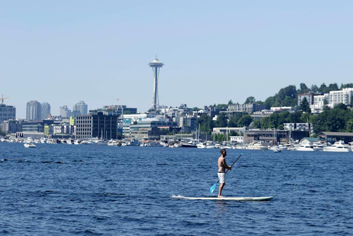 A person rides on a paddle board on Lake Union on June 27 in Seattle during a heat wave hitting the Pacific Northwest.