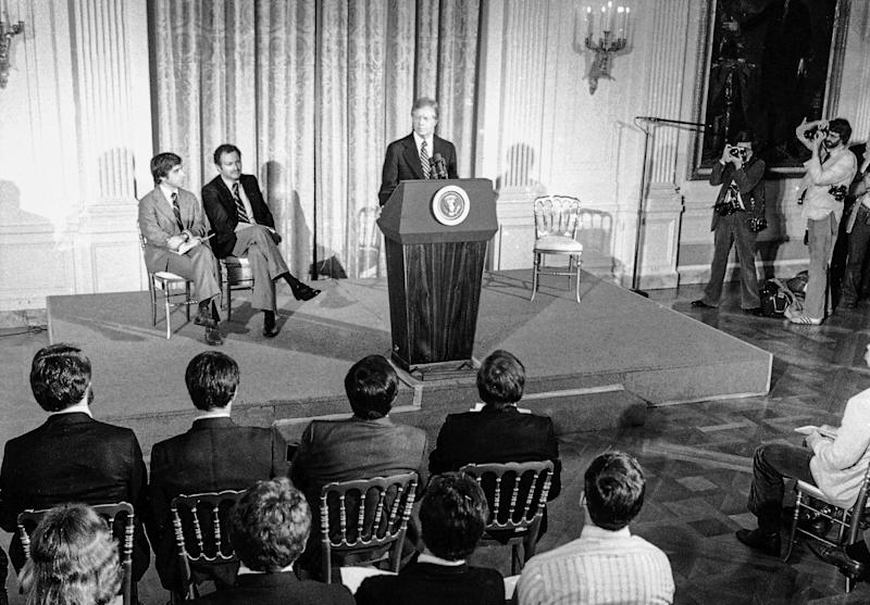 President Jimmy Carter addresses athletes who are to compete in the Summer Olympic Games in Moscow at the White House in Washington on March 21, 1980. The president asked them to support his proposed boycott of the Games to punish the Soviets for their invasion of Afghanistan. (AP)