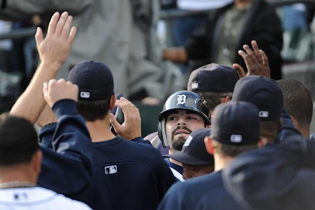 DETROIT, MI - OCTOBER 13: Alex Avila #13 of the Detroit Tigers celebrates in the dugout after hitting a solo home run in the third inning of Game Five of the American League Championship Series against the Texas Rangers at Comerica Park on October 13, 2011 in Detroit, Michigan. (Photo by Harry How/Getty Images)