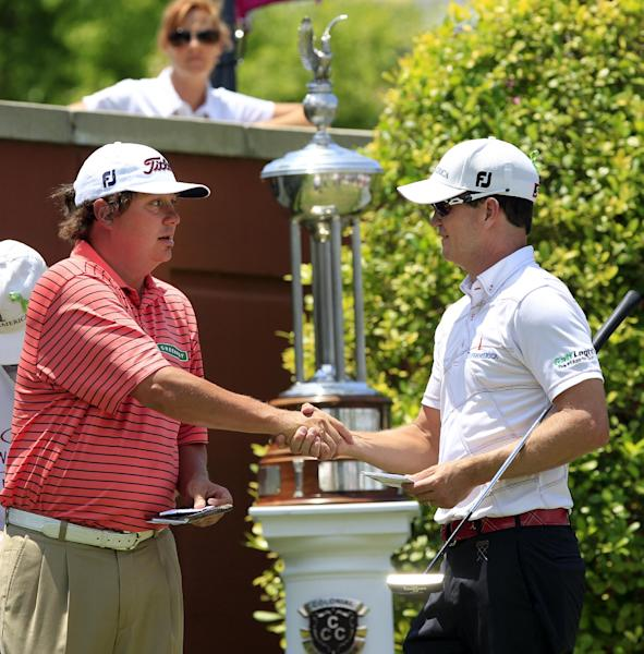 Jason Dufner, left, shakes hands with Zach Johnson before the final round of the PGA Colonial golf tournament, Sunday, May 27, 2012, in Fort Worth, Texas. (AP Photo/LM Otero)