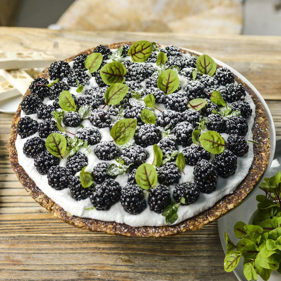"<p>The secret ingredient in this beautiful berry tart? <a href=""https://www.foodandwine.com/slideshows/dates"" target=""_blank"">Dates</a>! The sweet fruit holds the crust together and creates a pretty marbling effect.</p> <p> <a href=""https://www.foodandwine.com/recipes/raw-berry-tart-coconut-cream"">Go to Recipe</a></p>"