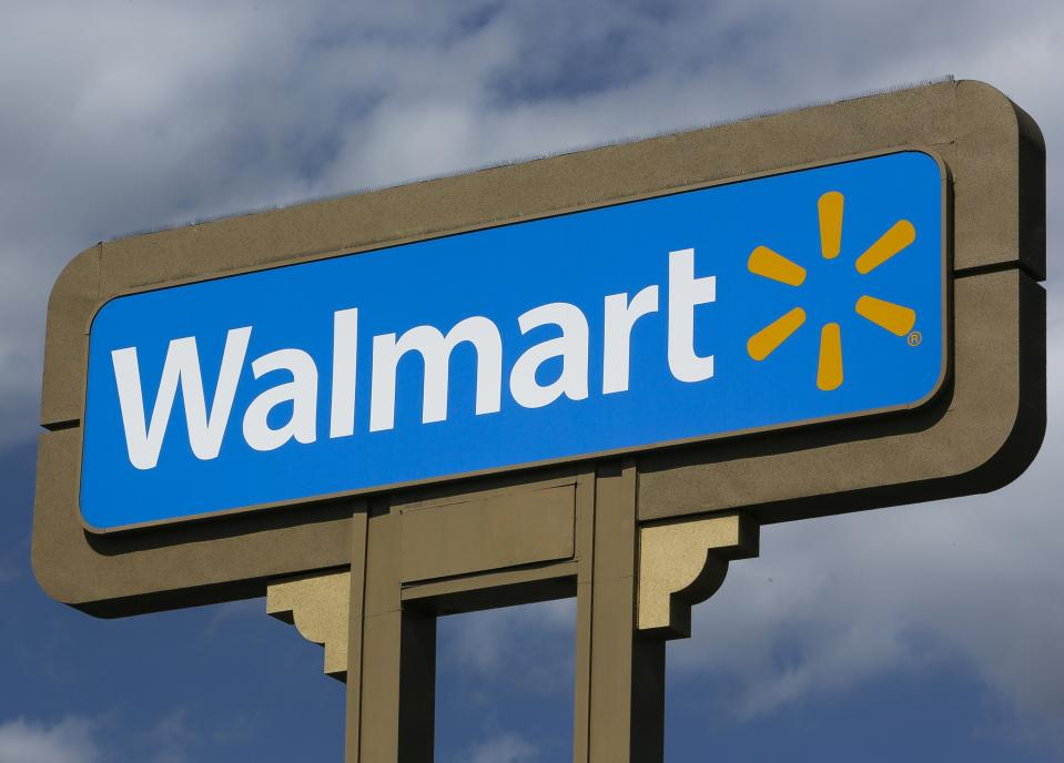 <p> FILE - In this Tuesday, May 28, 2013, file photo, An outdoors sign for Walmart is seen in Duarte, Calif. As more stores push for Thanksgiving shoppers, Wal-Mart Stores Inc. said Tuesday, Nov. 12, 2013, that it will start to offer its holiday blockbuster deals at 6 p.m. on Thanksgiving at its stores, two hours earlier than last year. (AP Photo/Damian Dovarganes, File)</p>