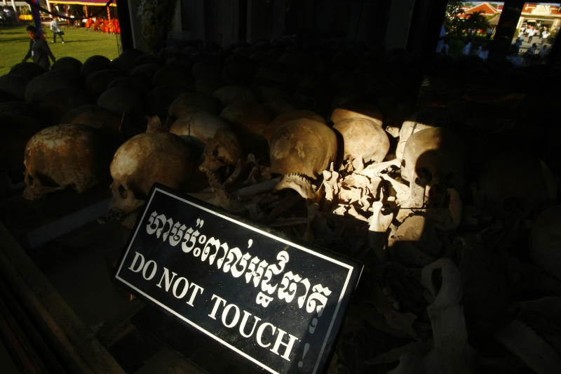 "In this photo taken, May 20, 2013, hundreds of former Khmer Rouge victims' bone and skulls are displayed in a memorial at Choeung Ek ""Killing Field"" in Phnom Penh, Cambodia. Cambodian Prime Minister Hun Sen appealed Monday, May 27, to member of parliaments urgently drafting a law in aims to punishment an opposition party leader from he recently comments that former Khmer Rouge's notorious S-21 prison was not real but created by Vietnamese, a move that could bar his opponent from participant upcoming election. (AP Photo/Heng Sinith)"