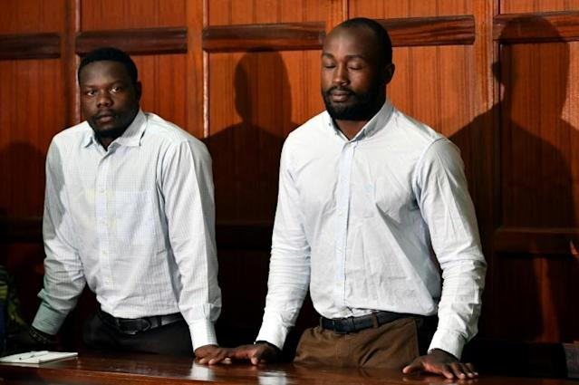 Alex Olaba and Frank Wanyama, seen in the dock, were both handed jail terms of 15 years over the rape of a singer (AFP Photo/TONY KARUMBA)