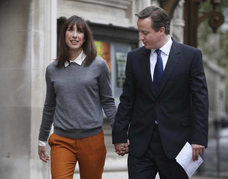 Prime Minister David Cameron and his wife Samantha arrive at the polling station at Methodist Central Hall in Westminster, London, to vote in the mayoral and council elections Thursday May 3, 2012. Opinion polls indicate that London's outspoken, but well-liked, Conservative mayor Boris Johnson seems on course to retain City Hall in British elections. (AP Photo / Peter Macdiarmid)