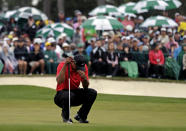 <p>Tiger Woods waits to putt on the 18th green during the fourth round of the Masters golf tournament Sunday, April 14, 2013, in Augusta, Ga. (AP Photo/David J. Phillip) </p>