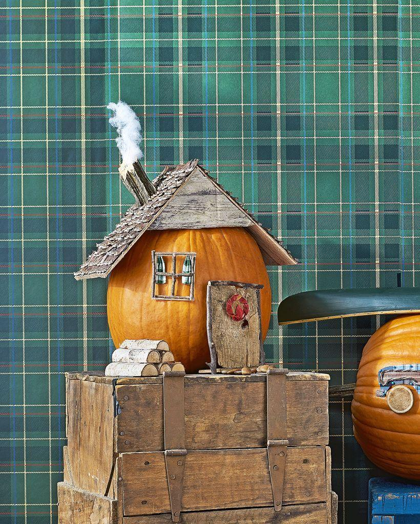 """<p>This adorable cabin design will make Halloween feel like home sweet home.</p><p><strong><em>Get the tutorial at <a href=""""https://www.countryliving.com/diy-crafts/g1350/pumpkin-decorating-1009/"""" rel=""""nofollow noopener"""" target=""""_blank"""" data-ylk=""""slk:Country Living"""" class=""""link rapid-noclick-resp"""">Country Living</a>. </em></strong> </p>"""
