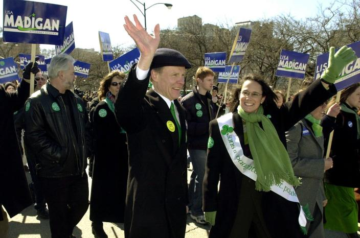 FILE - In this March 16, 2002 file photo, Illinois Democratic Attorney General candidate Lisa Madigan, right, walks in the St. Patrick's Day parade with her father, then Illinois House Speaker Michael Madigan, left, in Chicago. State Rep. Madigan, a Chicago Democrat who virtually set Illinois' political agenda as House speaker before he was ousted last month, announced Thursday, Feb. 18, 2021, that he is resigning his seat in the Legislature. (AP Photo/Stephen J. Carrera File)