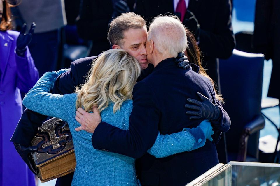 Hunter Biden hugs his father and his wife, Jill, after Joe Biden is sworn in as president of the United States.  (Photo: Drew Angerer via Getty Images)